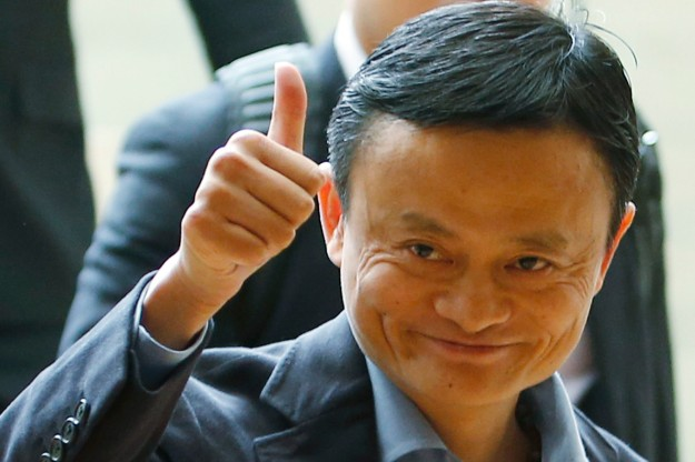 Alibaba founder Jack Ma gives a thumbs up as he arrives to speak to investors at an initial public offering roadshow in Singapore